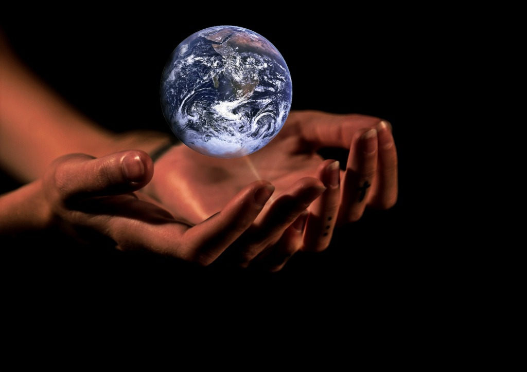 hands protecting earth